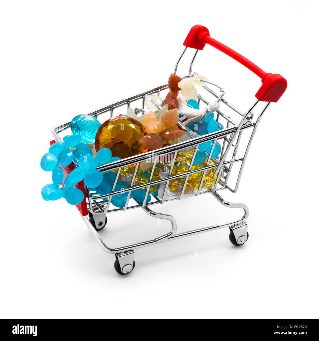 Shopping cart with gemstone beads. White background. - Stock Image