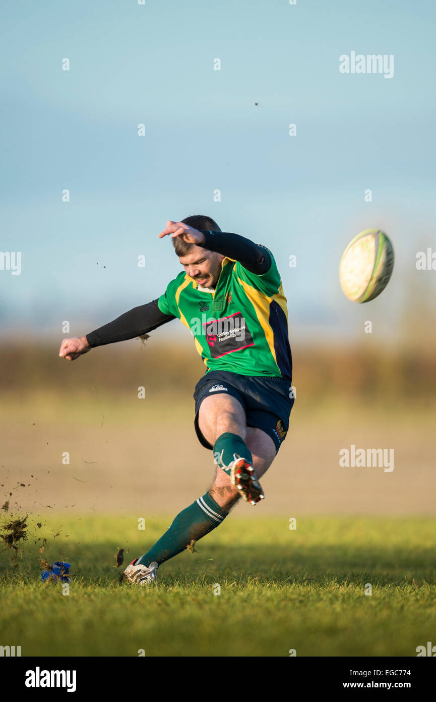 Rugby player kicking conversion. - Stock Image