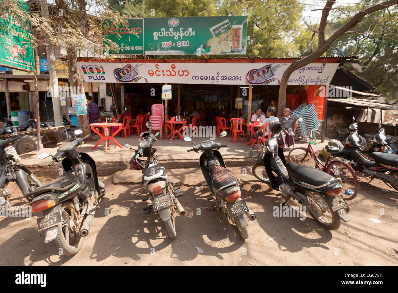 Motorcycles parked outside a bar, Nyaung U village, Bagan, Myanmar ( Burma ), Asia - Stock Image