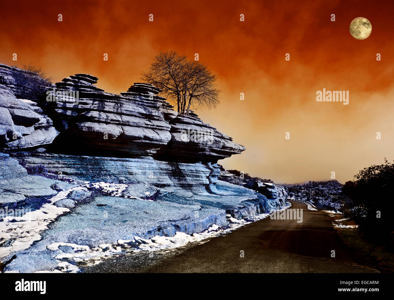 Infrared Image of the Moon rising over road through  El Torcal,  Antequera, Malaga Province,  Andalucia, Spain - Stock Image