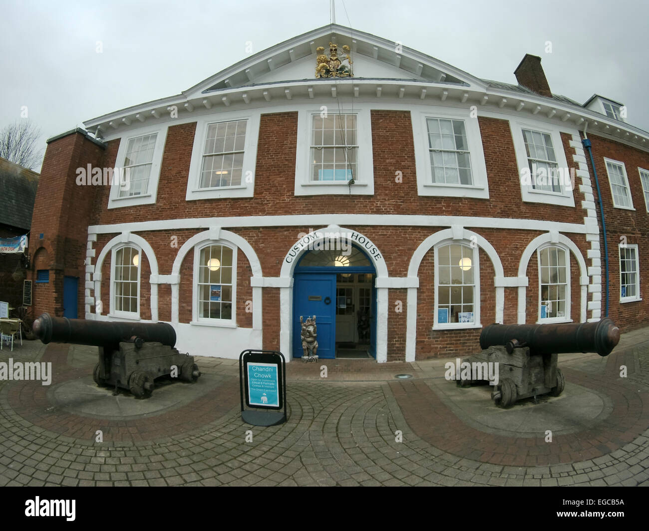 Cannon outside the Customs House Exeter Quay UK Built 1680-81 Fish eye view. - Stock Image