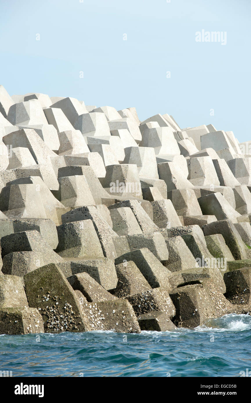 Concrete forms interlocked to make a sea wall breakwater. Stock Photo