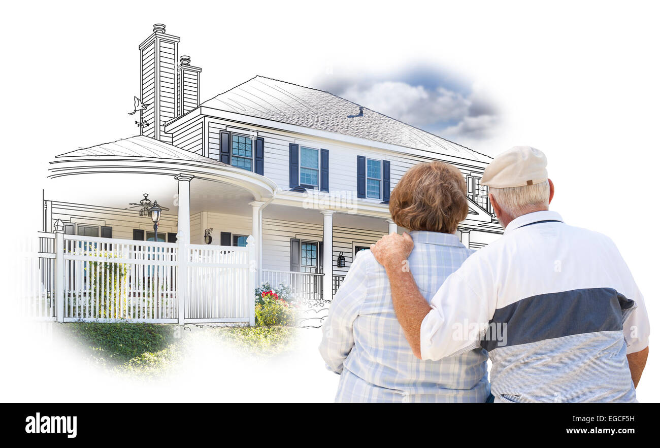 Curious Embracing Senior Couple Looking At  House Drawing and Photo Combination on White. - Stock Image