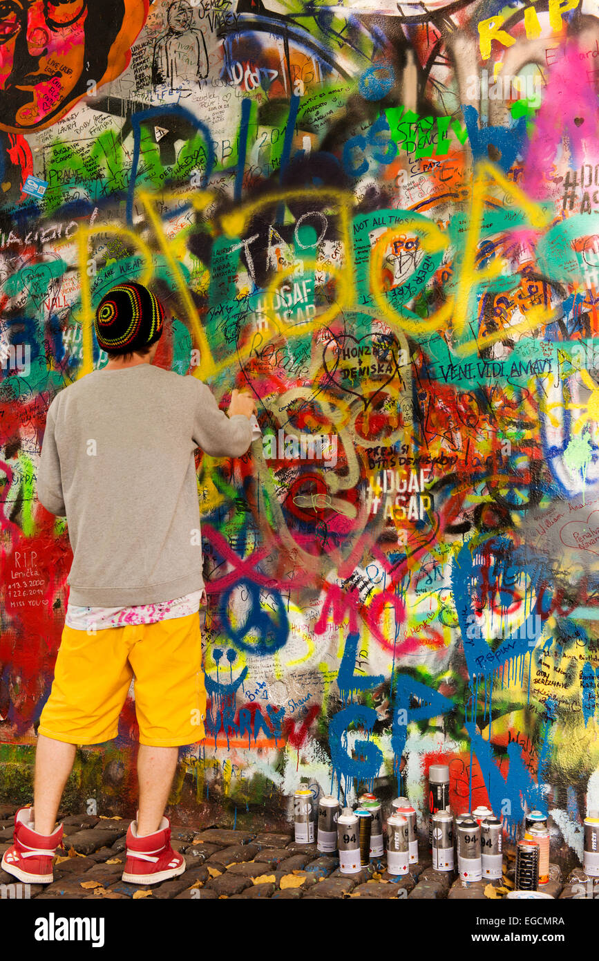 Spray paint artist working at The Lennon Wall in Prauge. - Stock Image