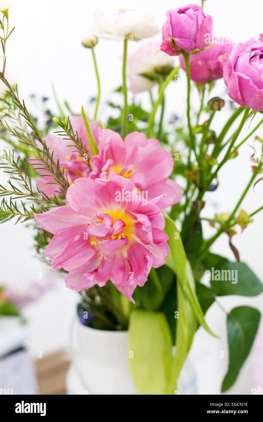 Amazing rose tulips bouquet in vase Stock Photo