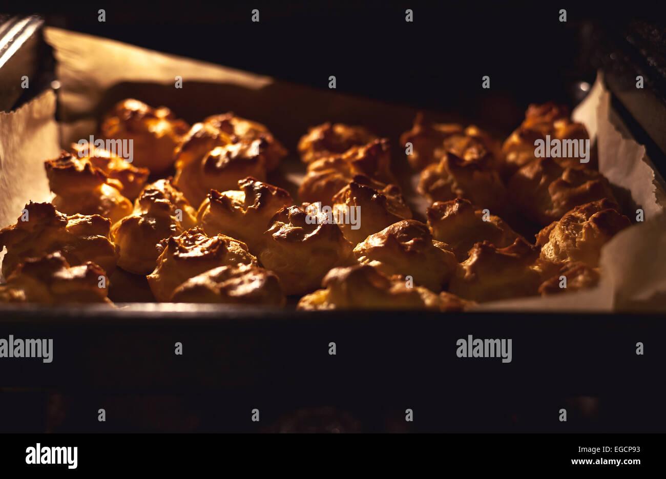 Preparing sweet tasty buns for pudding cake. - Stock Image