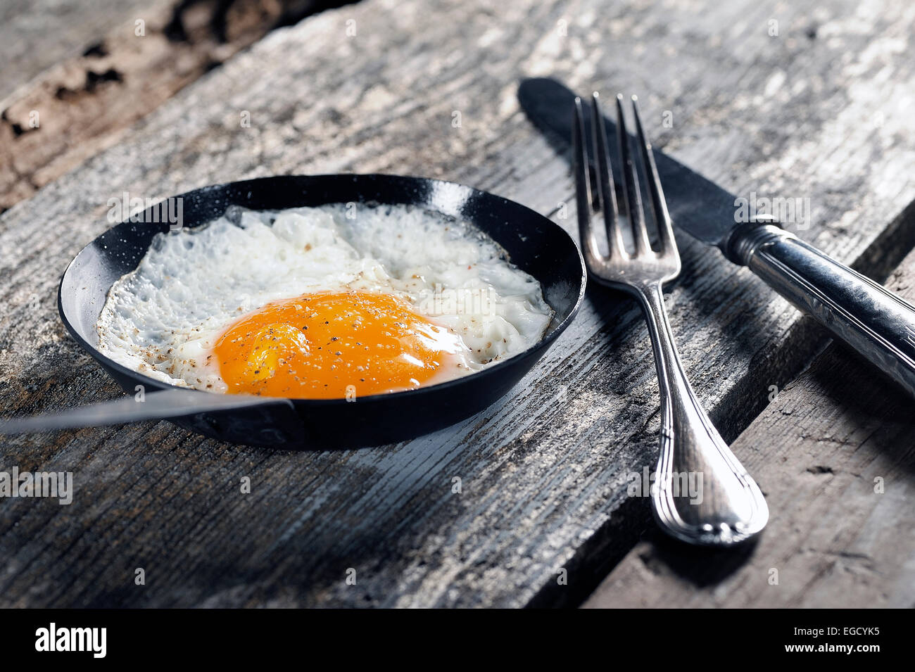 Fried egg, fried in a pan - Stock Image