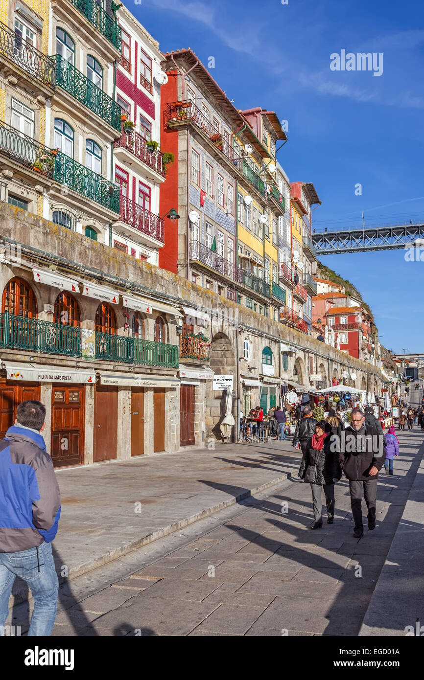 Porto, Portugal. The typical colorful buildings of the Ribeira District with shops, restaurants and bars built in - Stock Image