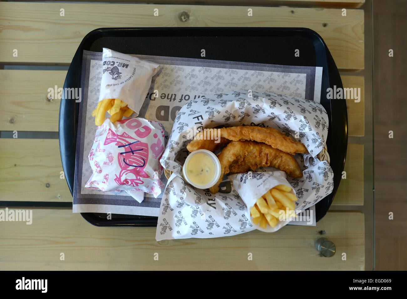 Fish and chips at display at the newly-opened Mr Cod, a British-style fish and chip restaurant, in Kabul 19 February - Stock Image