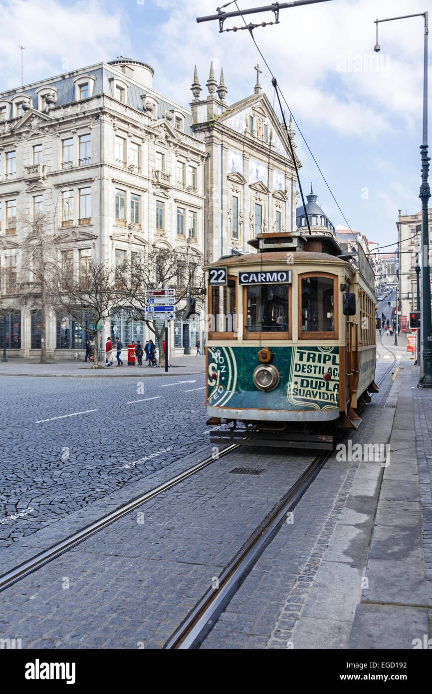 Porto, Portugal. The old tram 22 passes by Aliados Avenue and Liberdade Square with the Congregados Church in background. Stock Photo