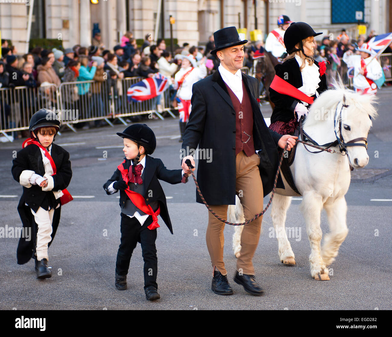 This pony and its team of small riders were definitely among the most popular participants in the 2013 New Year's - Stock Image