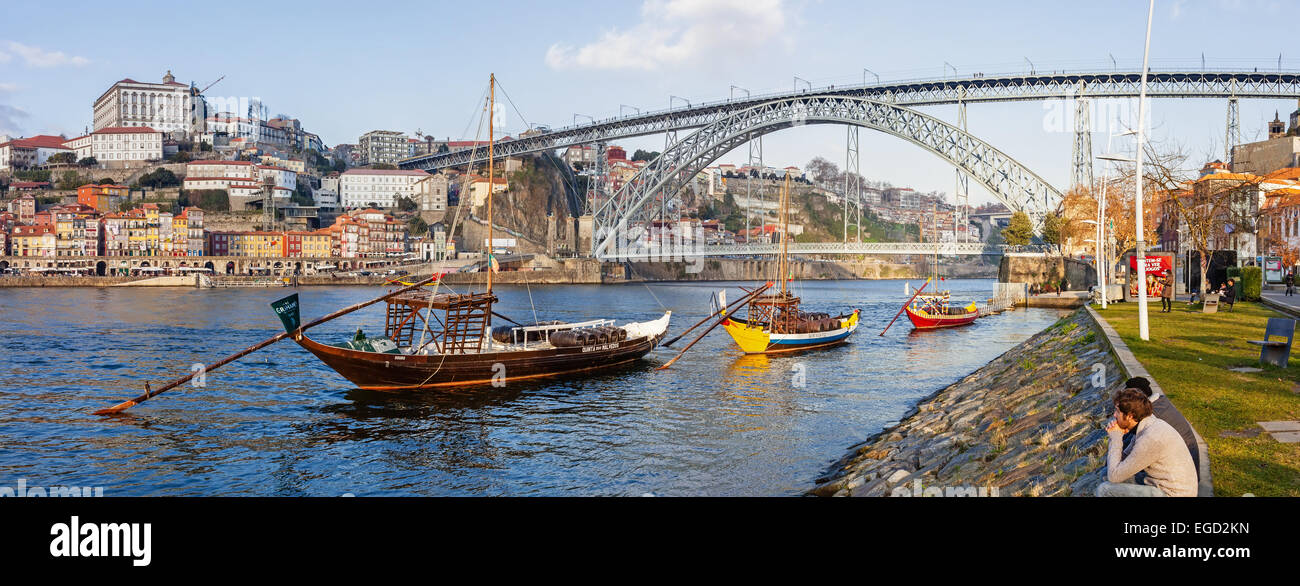 The iconic Rabelo Boats, the traditional Port Wine transports, with the Ribeira District and the Dom Luis I Bridge - Stock Image