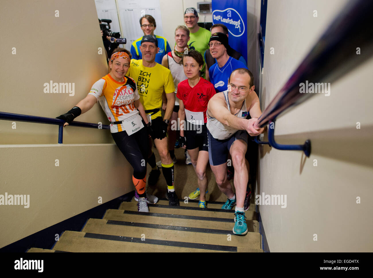 Participants run up a flight of stairs during the  staircase marathon in Hanover, Germany, 21 February 2015. According - Stock Image