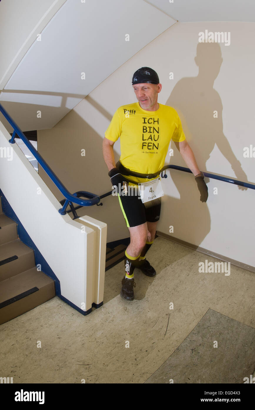 Participants Frank Pachura runs up a flight of stairs during the  staircase marathon in Hanover, Germany, 21 February - Stock Image