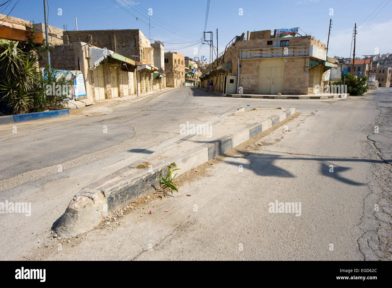 HEBRON, ISRAEL - 10 OCT,  2014: Deserted street near the center of Hebron where the second intifada in 2000 was - Stock Image