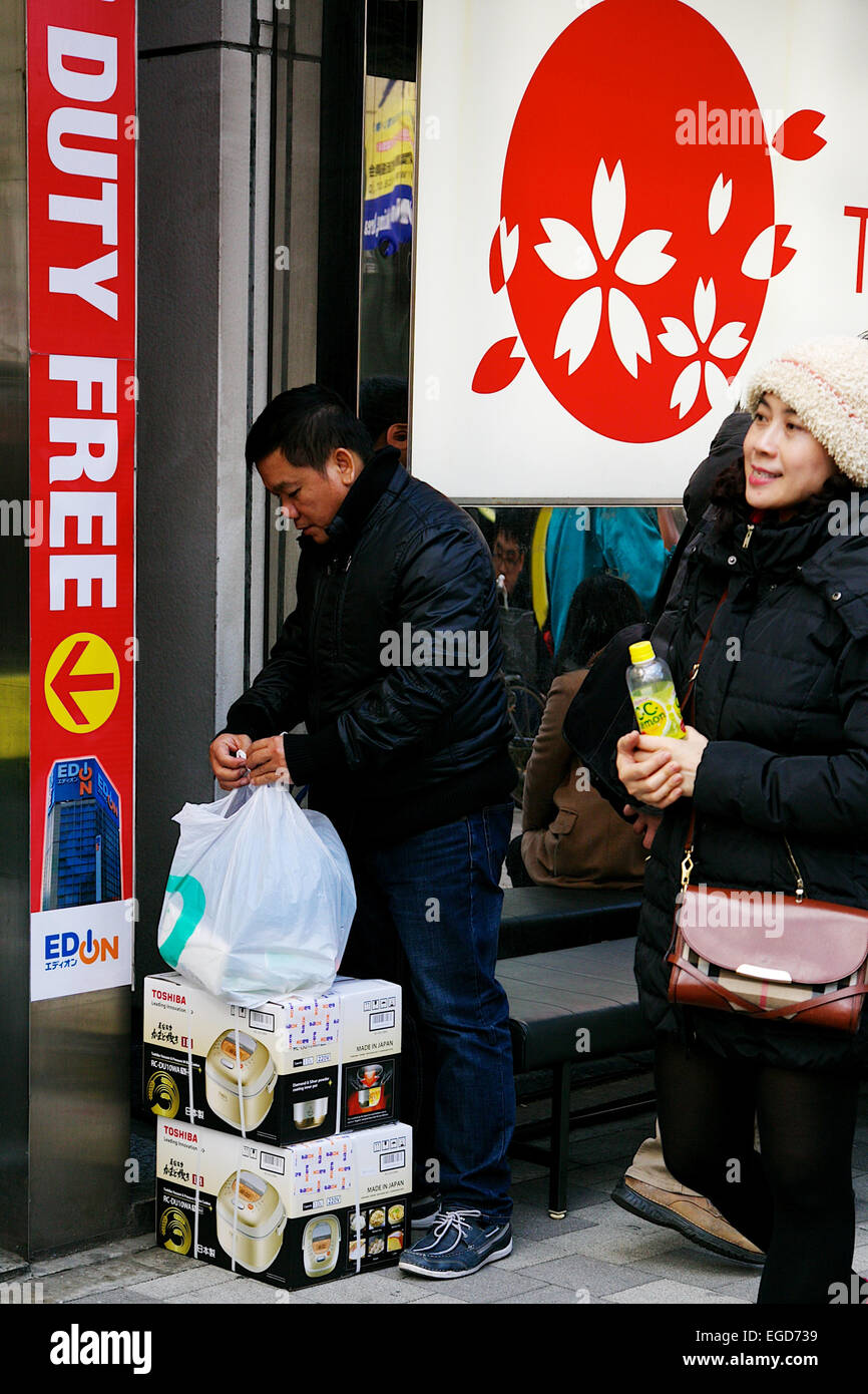 Asian tourists shopping during the Lunar New Year Holiday on February 20, 2015 in Tokyo, Japan. An asian shopper Stock Photo