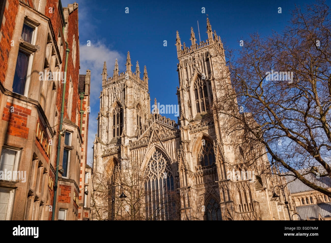The West Front of York Minster, and on the left, the Dean Court Hotel. - Stock Image
