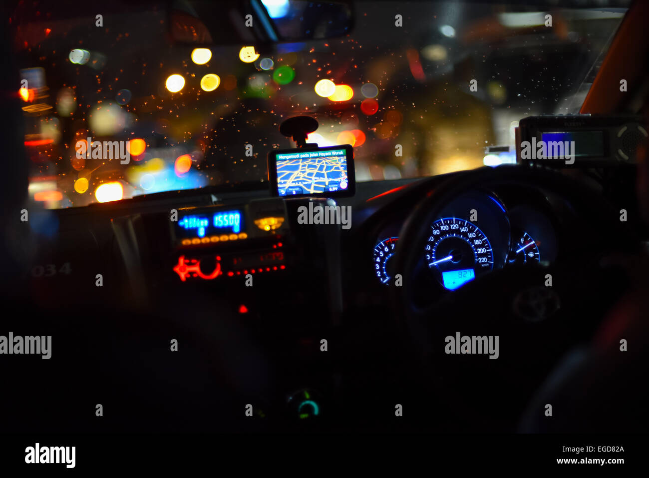 dashboard of a taxi in night traffic jakarta stock photo 78967682 alamy. Black Bedroom Furniture Sets. Home Design Ideas