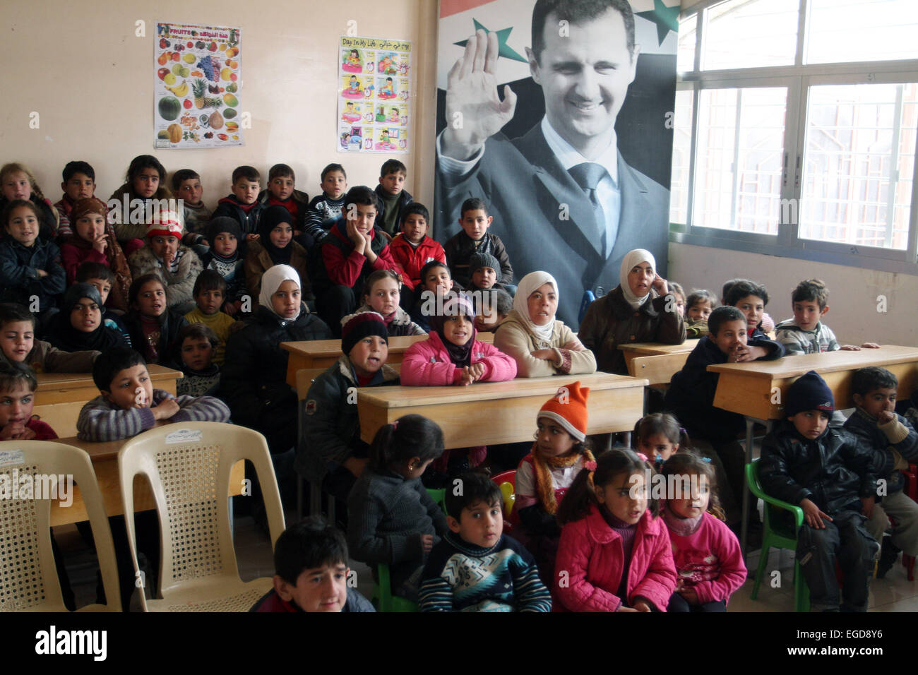 Damascus. 23rd Feb, 2015. Displaced Syrian children are seen at a school that has been turned into a temporary shelter - Stock Image