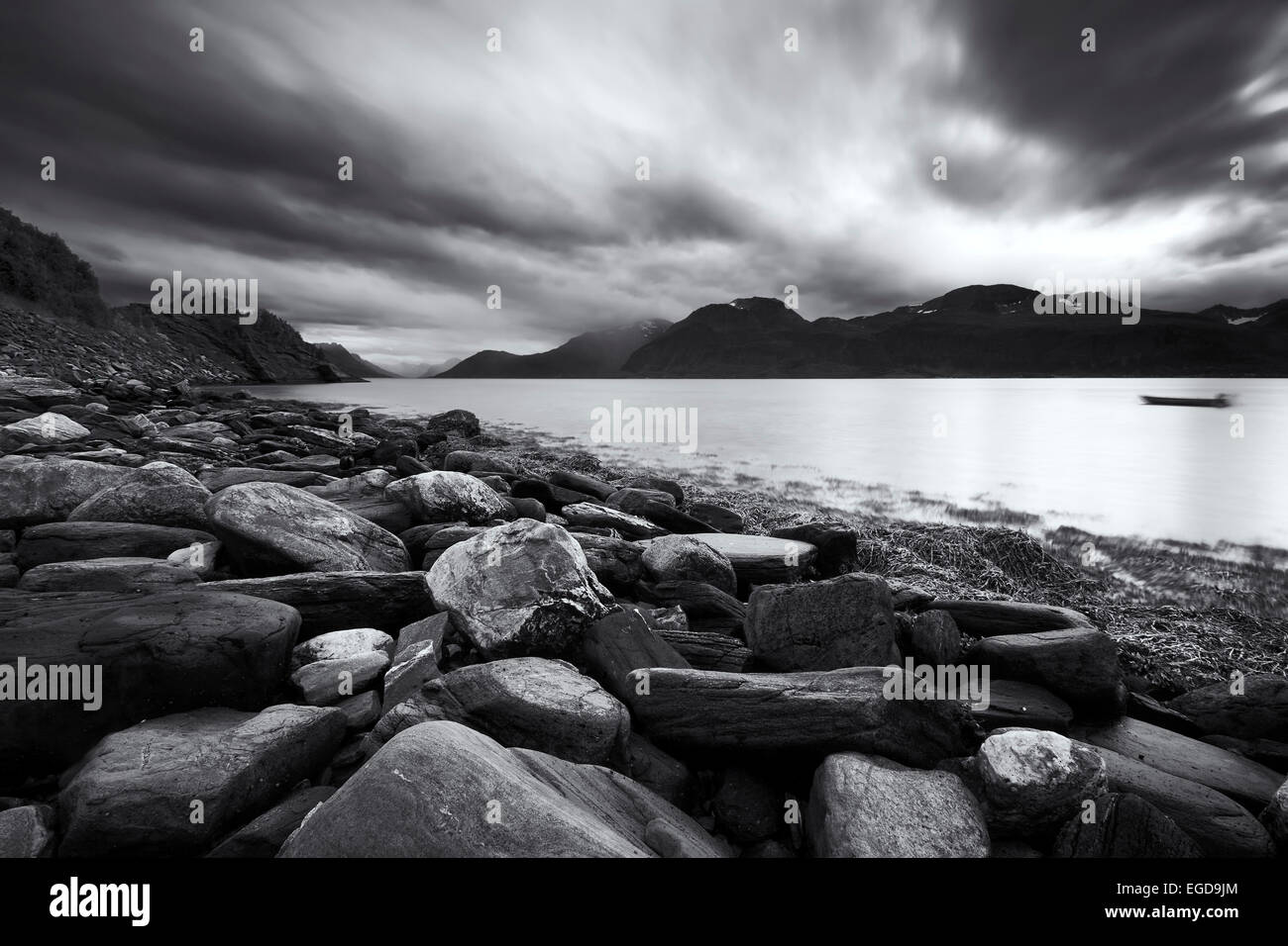 Black and white shot of the rugged terrain of the Lyngen Fjord in Autumn, Troms, Norway - Stock Image