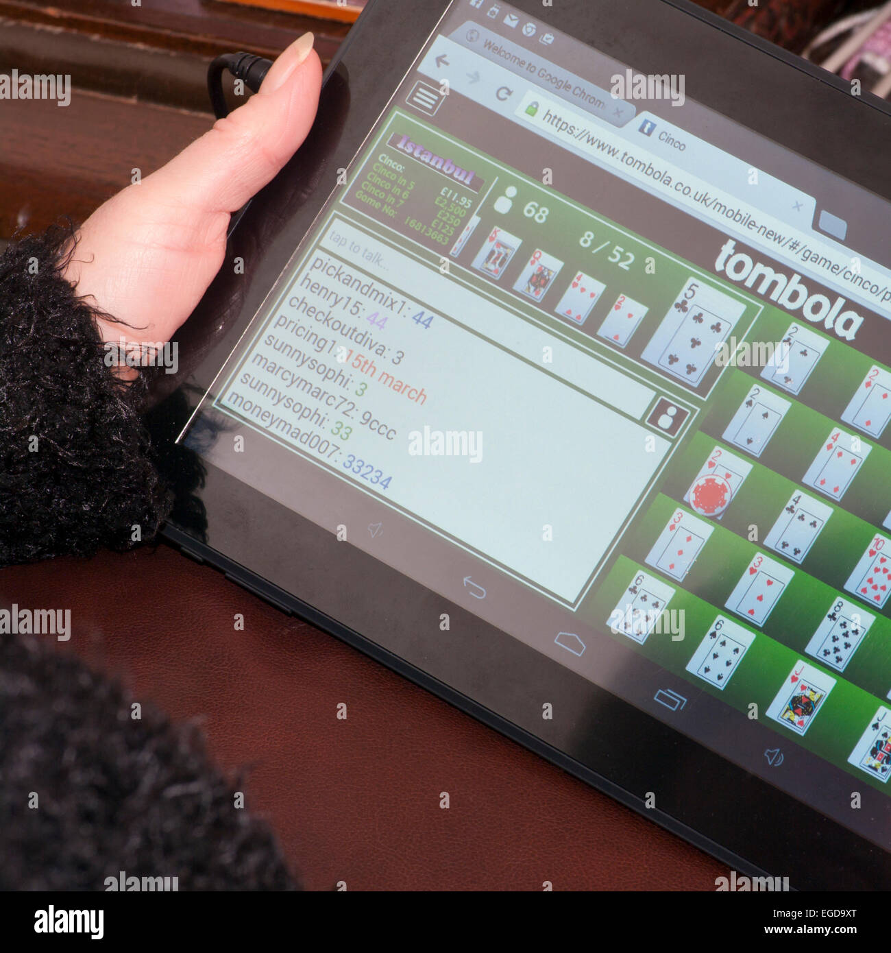 Woman Online Gambling Playing Cinco On The Tombola Bingo Website On A Tablet - Stock Image