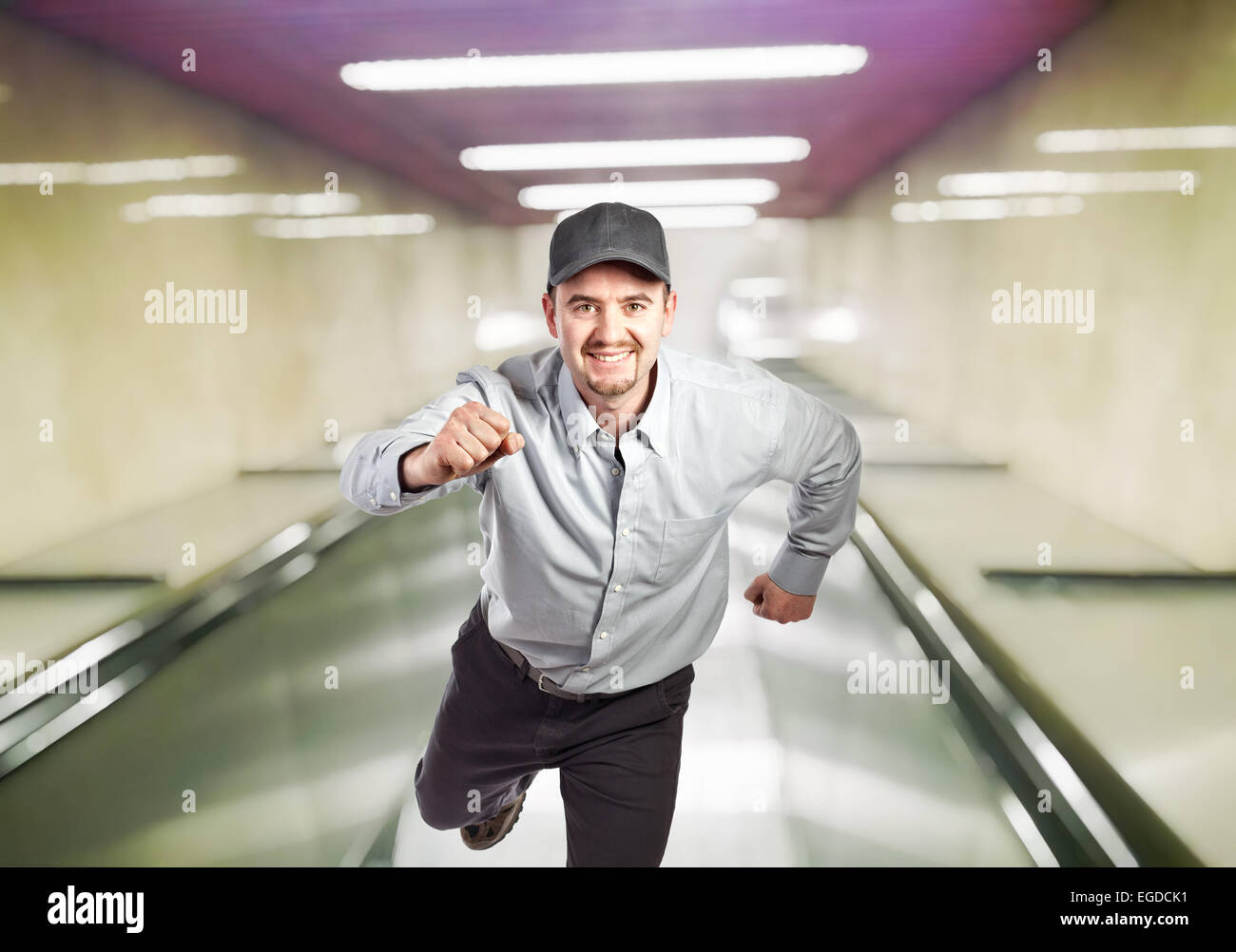 running manual worker and escalator background - Stock Image
