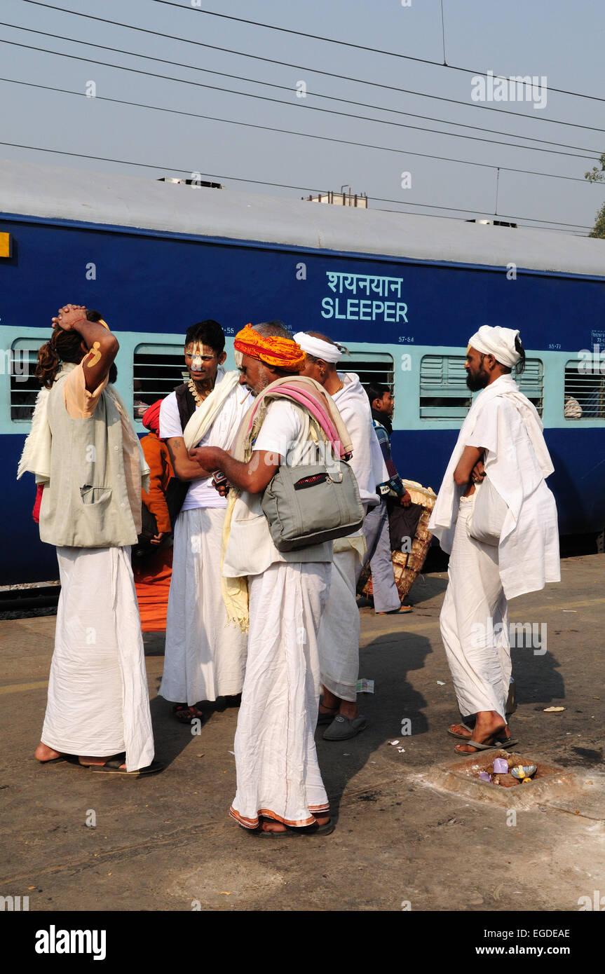 Group of Vishnu Devotees Sadhu Indian Holy Men  waiting for a train at Delhi Railway Station India Stock Photo