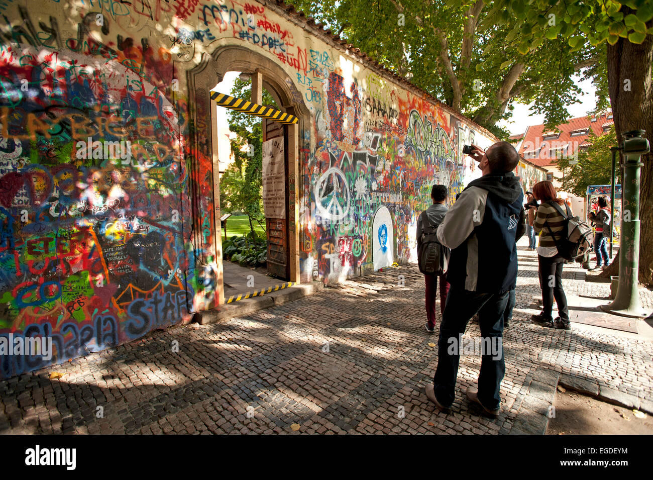 Graffiti along the Lennon Wall at the Grand Priory Square, Prague, Czech Republic, Europe - Stock Image