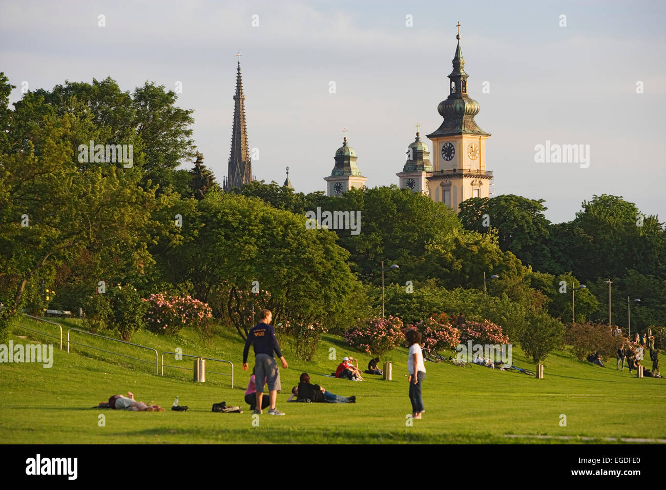 The flood zone of the Danube is normally a green park. Steeples of the new cathedral, Mary-Immaculate-Conception Stock Photo