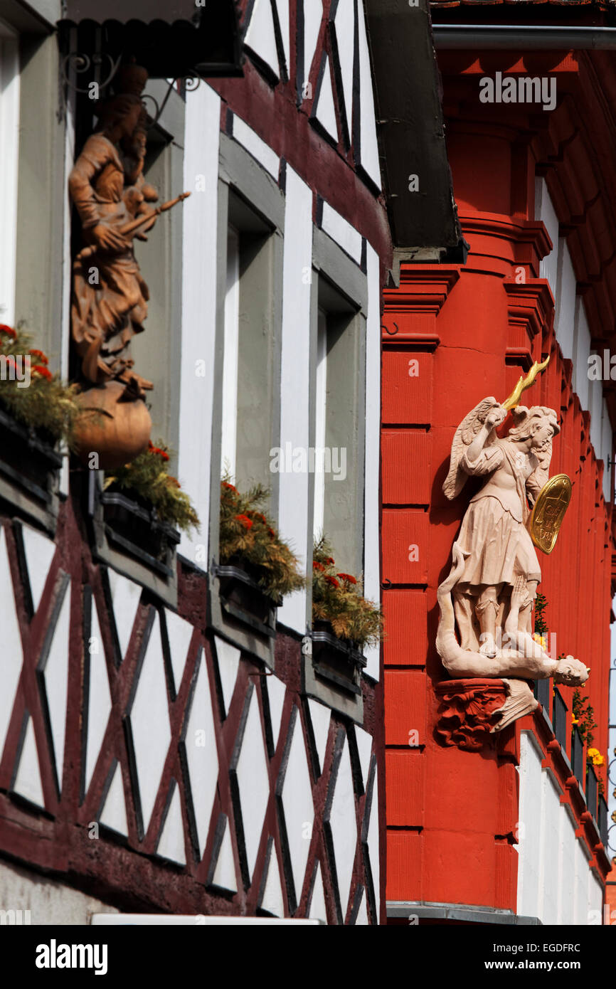 Details on the facades of two timber framed houses, Volkach, Lower Franconia, Bavaria, Germany - Stock Image