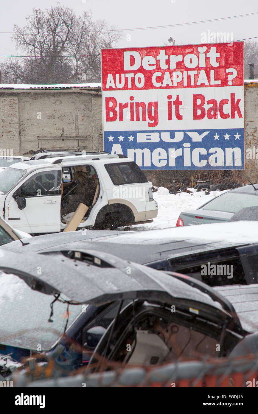 Detroit, Michigan - An auto junkyard with a sign urging 'Buy American.' - Stock Image