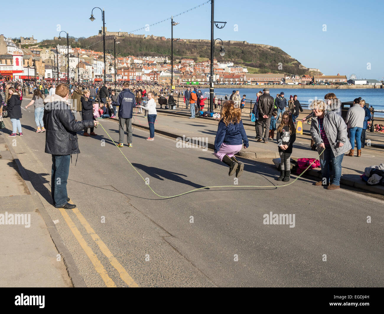 Traditional Shrove Tuesday skipping custom on the foreshore Scarborough Yorkshire UK - Stock Image