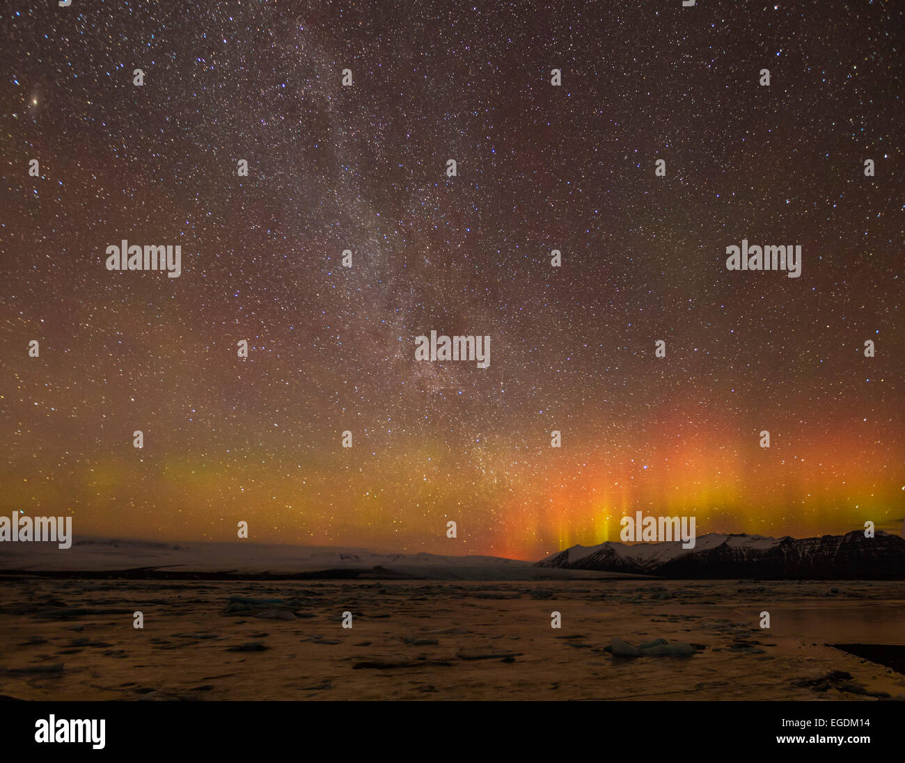 Aurora borealis or Northern Lights and Milky Way galaxy Jokulsarlon Iceland Europe - Stock Image