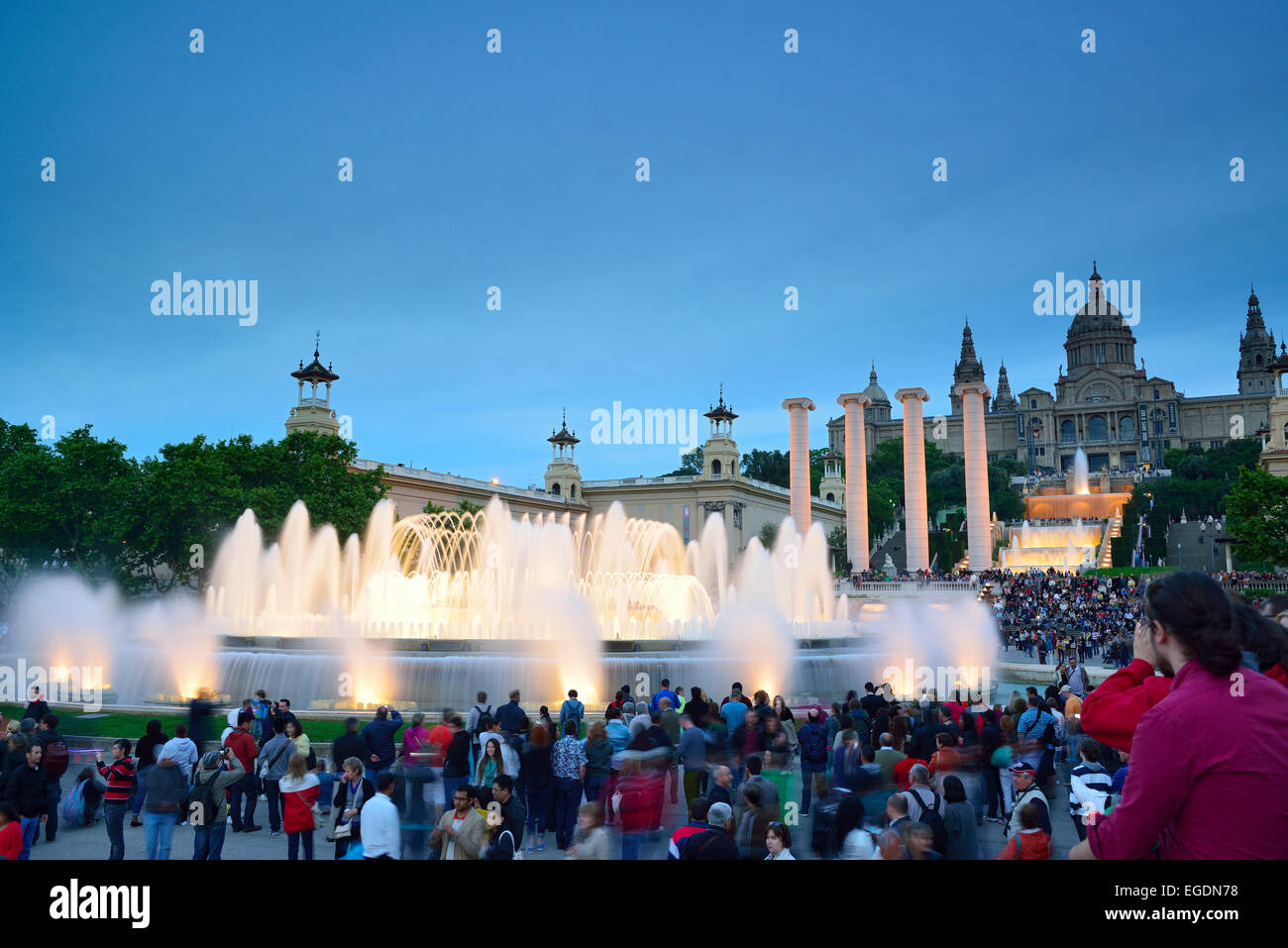 Illuminated fountain Font Magica and Palau Nacional in the evening, National Museum, Montjuic, Barcelona, Catalonia, - Stock Image