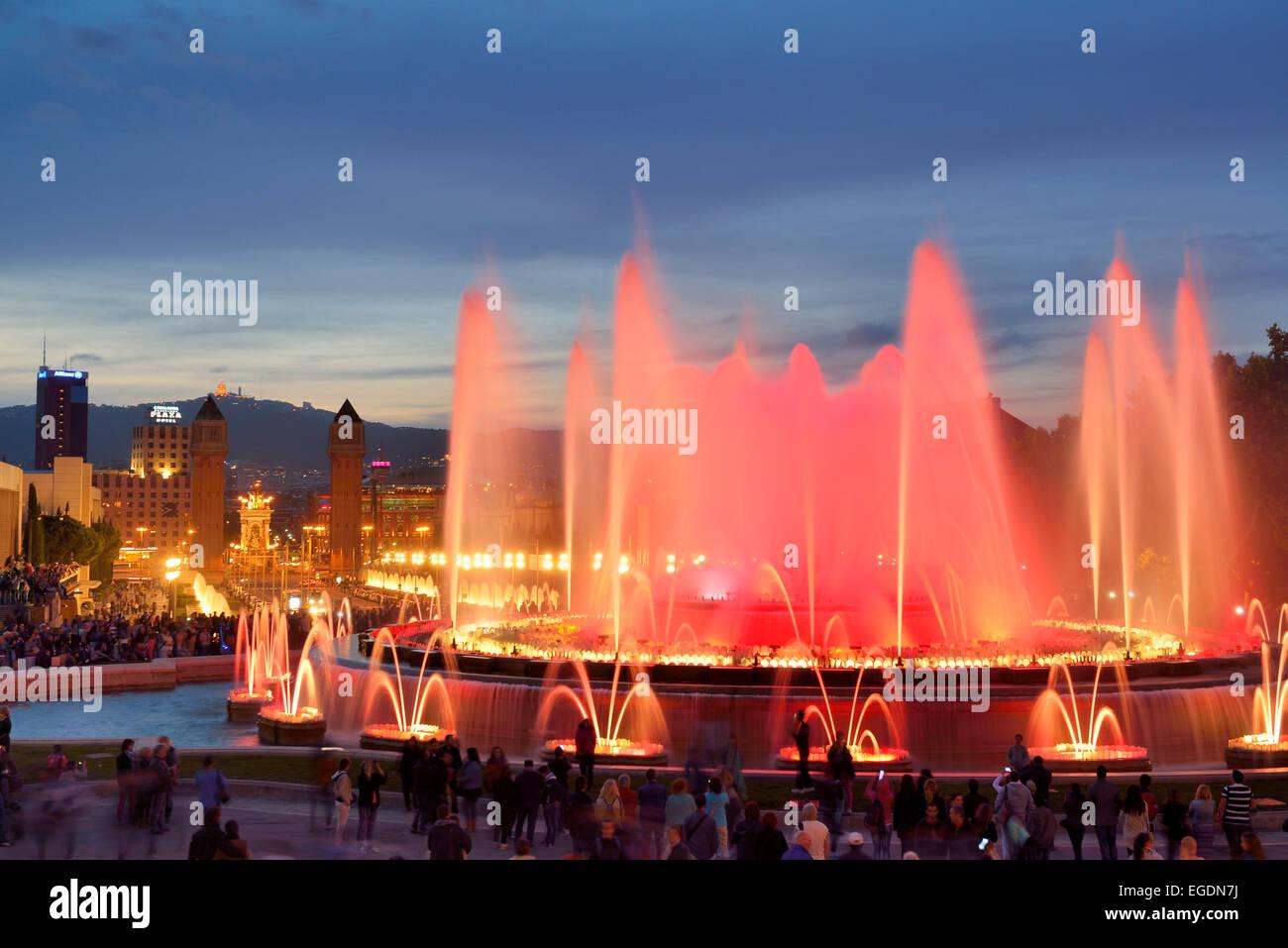 Illuminated fountain Font Magica and Palau Nacional at night, National Museum, Montjuic, Barcelona, Catalonia, Spain - Stock Image