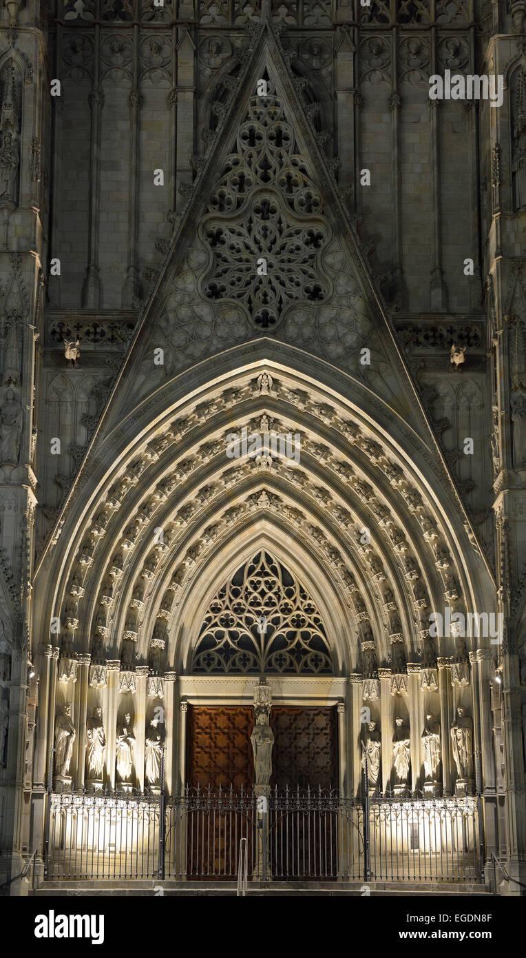 Illuminated portal of Barcelona cathedral, La Catedral de la Santa Creu i Santa Eulalia, Gothic architecture, Barri - Stock Image