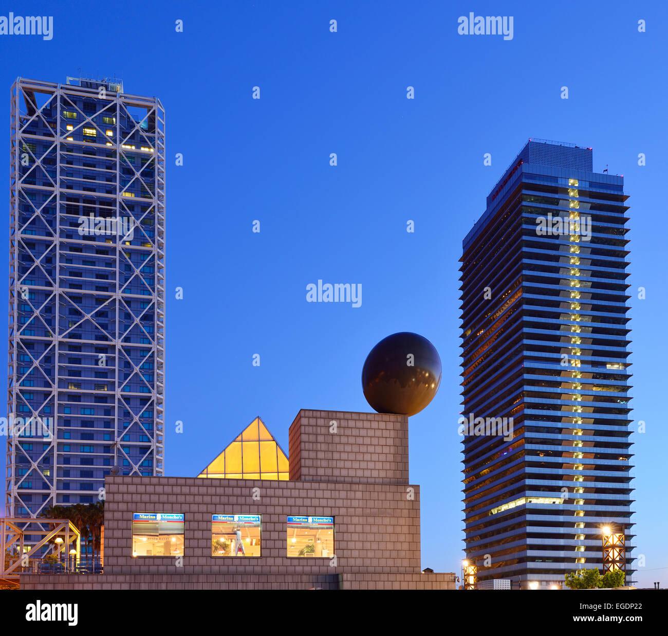 Twin towers Hotel Arts and Mapfre Tower, illuminated at night, Olympic village, Barceloneta, Barcelona, Catalonia, - Stock Image