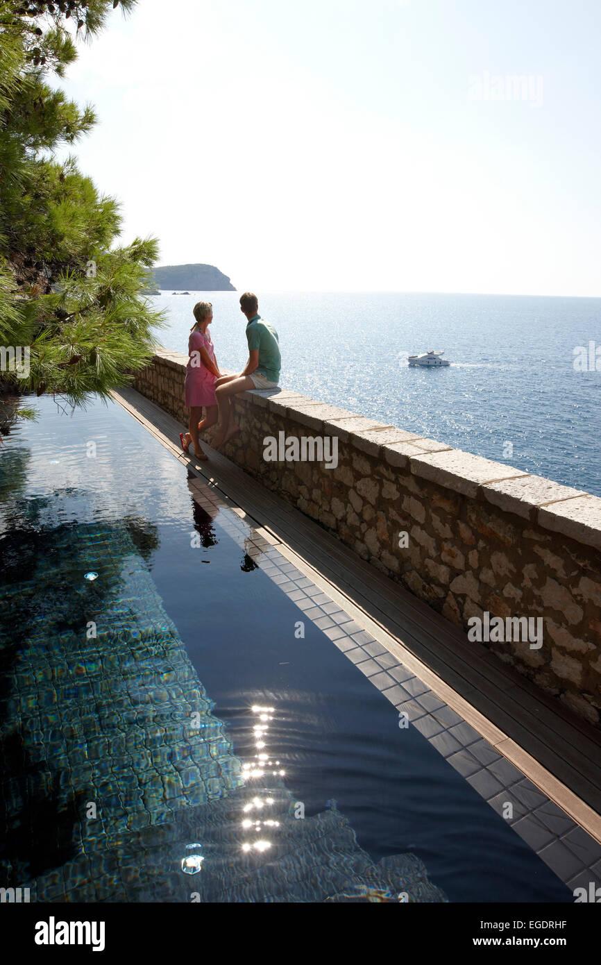 Guests at the Cliff Pool, Aman Sveti Stefan, Sveti Stefan, Budva, Montenegro - Stock Image