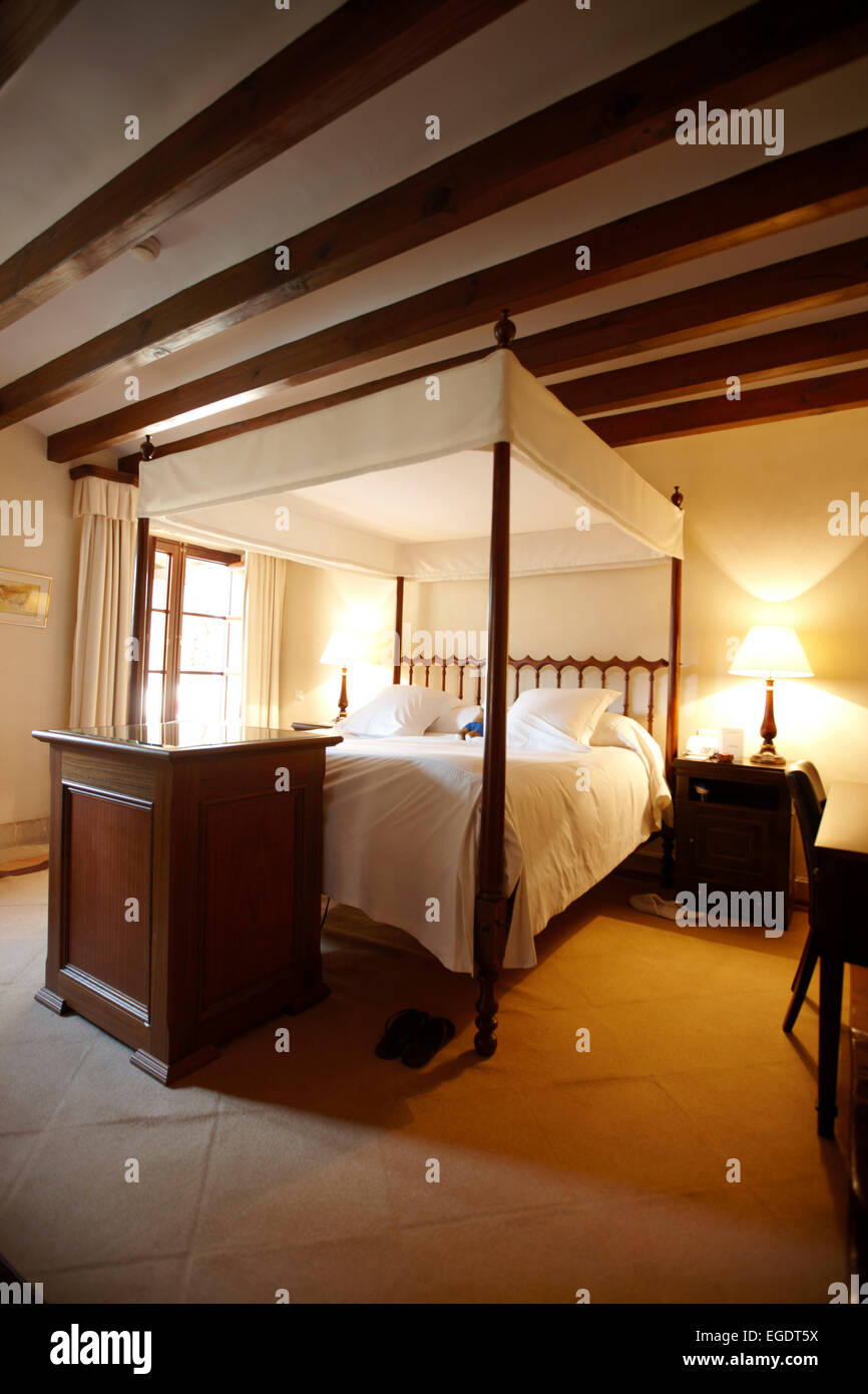 Hotel suite with four-poster bed, Deia, Majorca, Spain - Stock Image