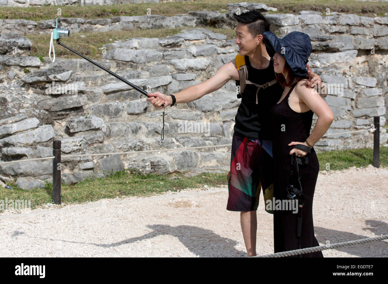 Tourists pose with a selfie stick at Tulum, Quintana Roo, Mexico - Stock Image
