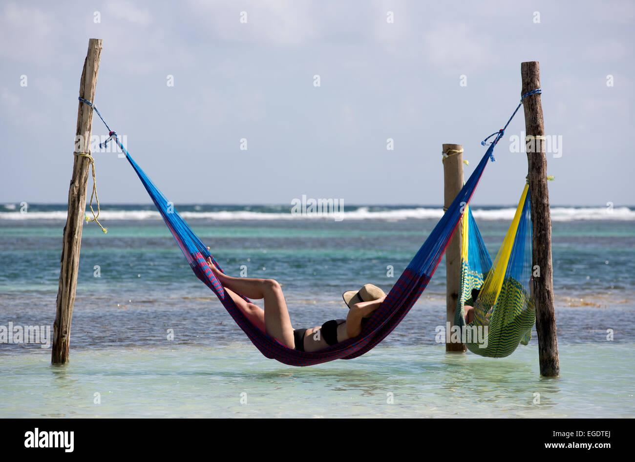 People in hammocks on the beach at Mahahual Quintana Roo Mexico - Stock Image