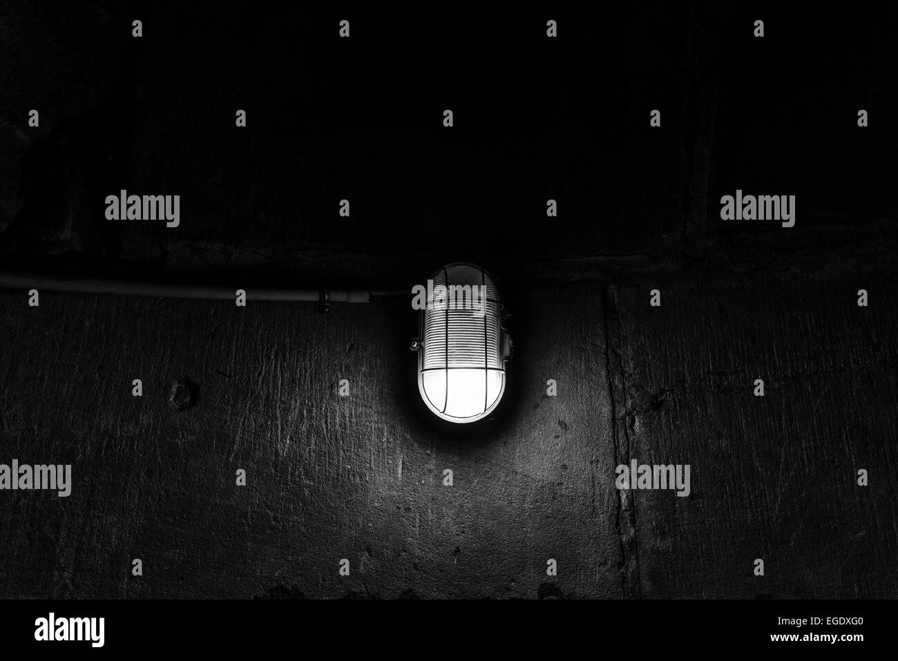a lamp in the darkness - Stock Image