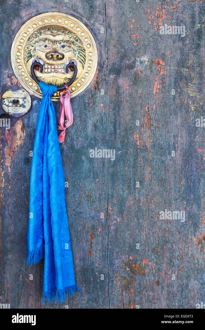 Blue ribbon tied to temple door, Erdene Zuu Khiid, Kharkhorin, Ovorkhangai, Mongolia - Stock Image