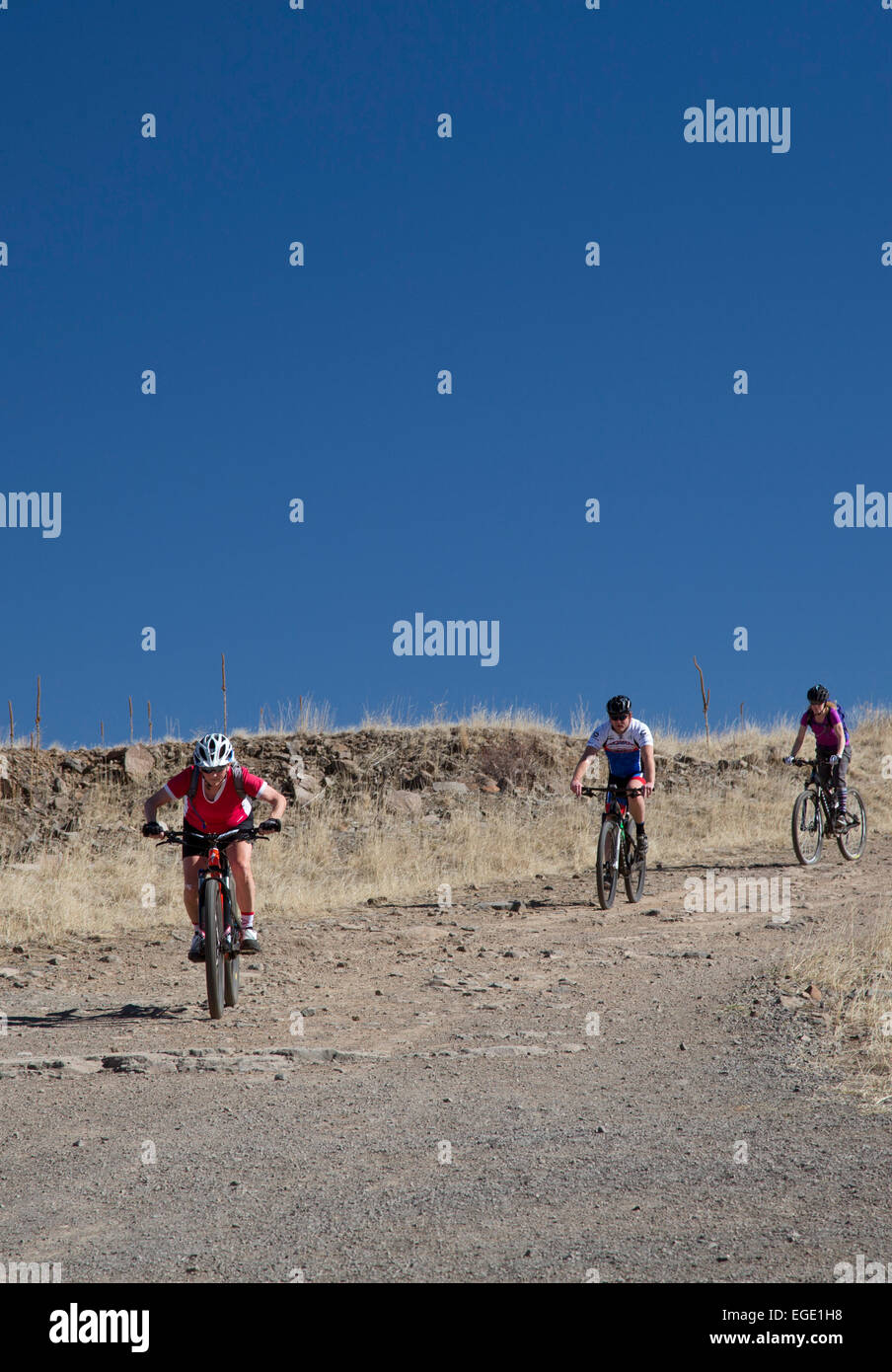 Golden, Colorado - Mountain bike riders on North Table Mountain, a mesa above Denver which is designated an 'open - Stock Image