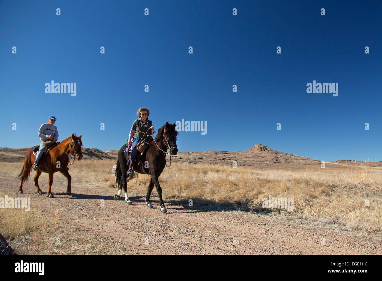 Golden, Colorado - Horseback riders on North Table Mountain, a mesa above Denver which is designated an 'open - Stock Image