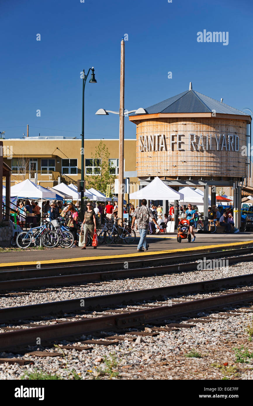 Water tower replica, shoppers at Farmers Market and railroad tracks, Santa Fe Railyard, New Mexico USA - Stock Image