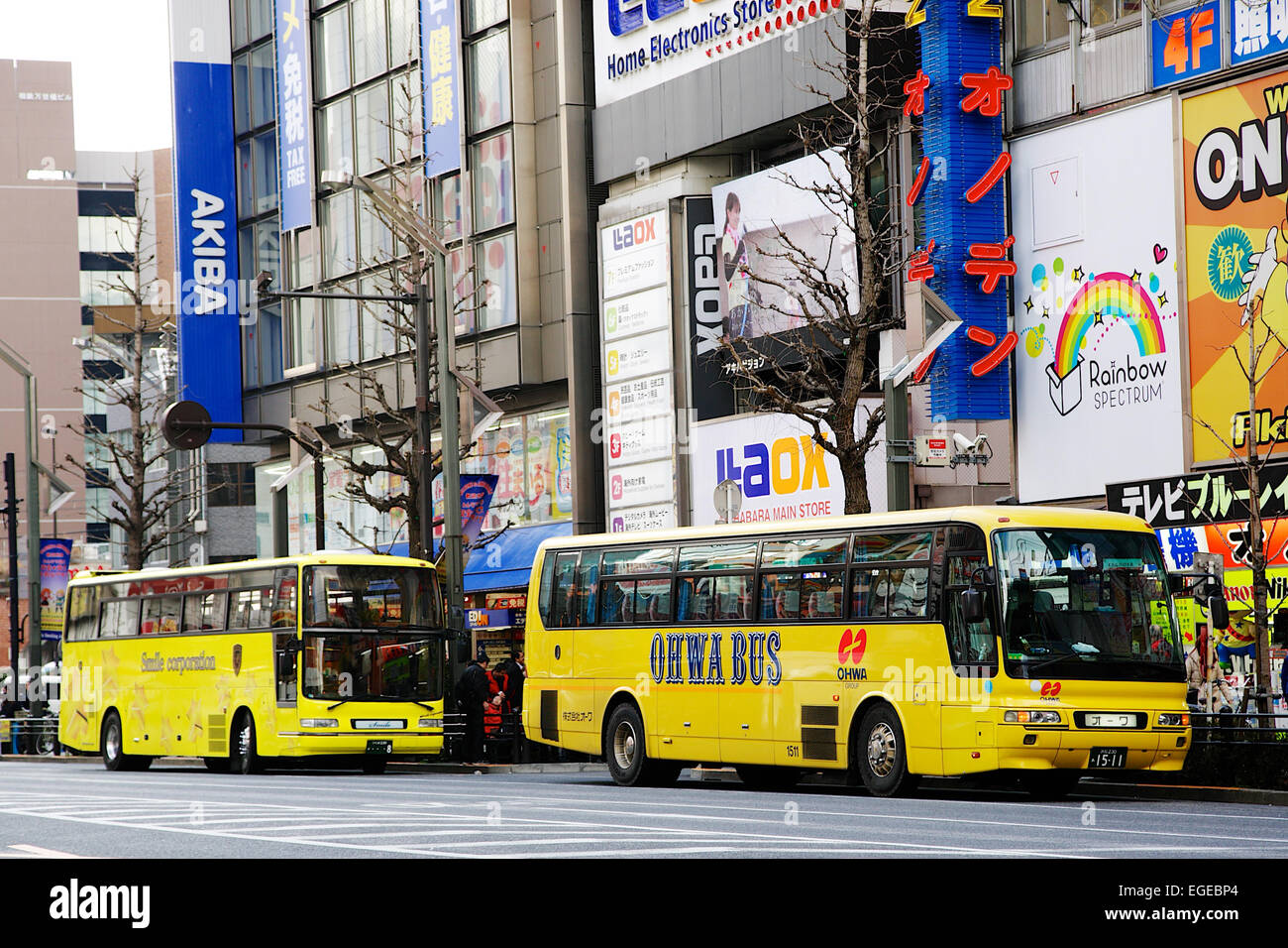 Asian tourists shopping during the Lunar New Year Holiday on February 20, 2015 in Tokyo, Japan. Tourist buses park Stock Photo