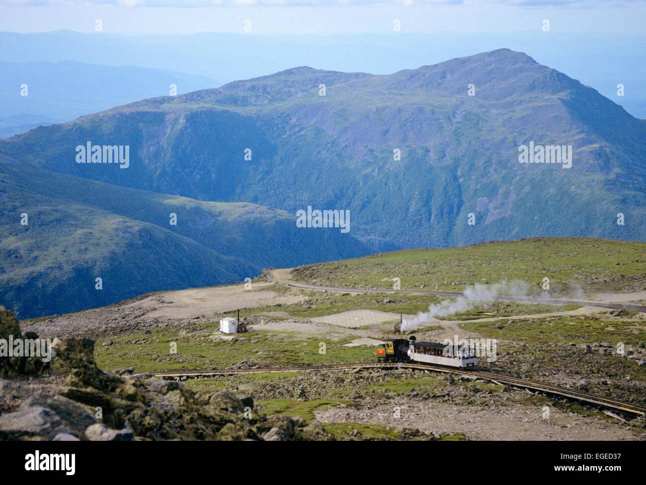 Cog train bringing passengers to the top of Mount Washington, New Hampshire, USA. - Stock Image