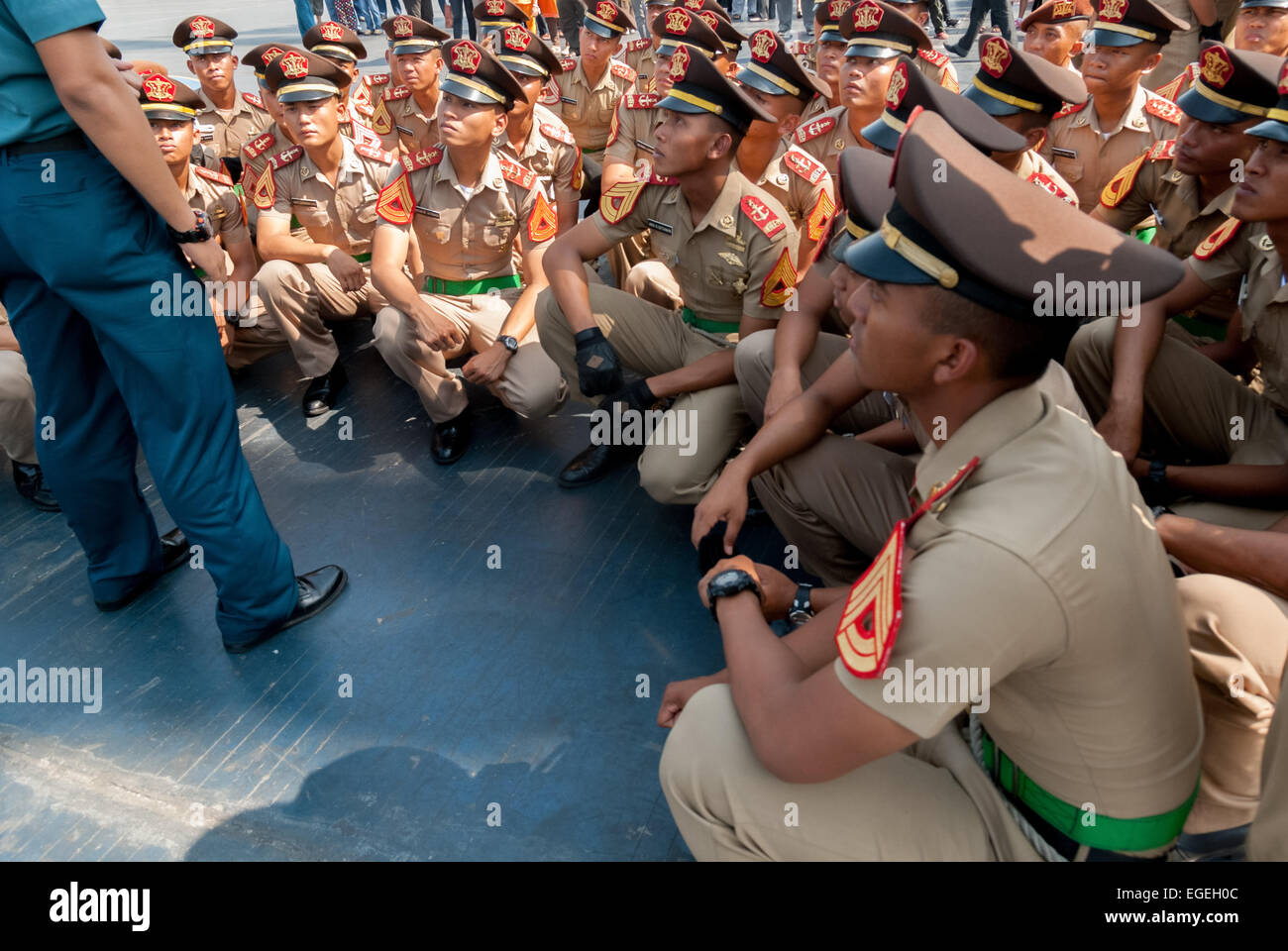 Indonesian navy cadets at a briefing before the last sail of the original Dewaruci tall ship in 2012. - Stock Image