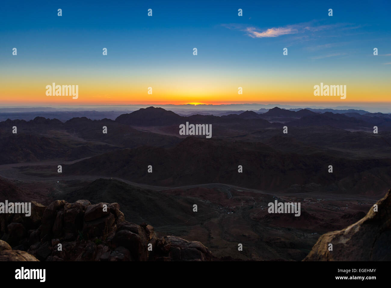Sunrise at Mount Sinai, Egypt. Bedouins bring tourists in the night to Mount Sinai, Egypt to meet sunrise - Stock Image